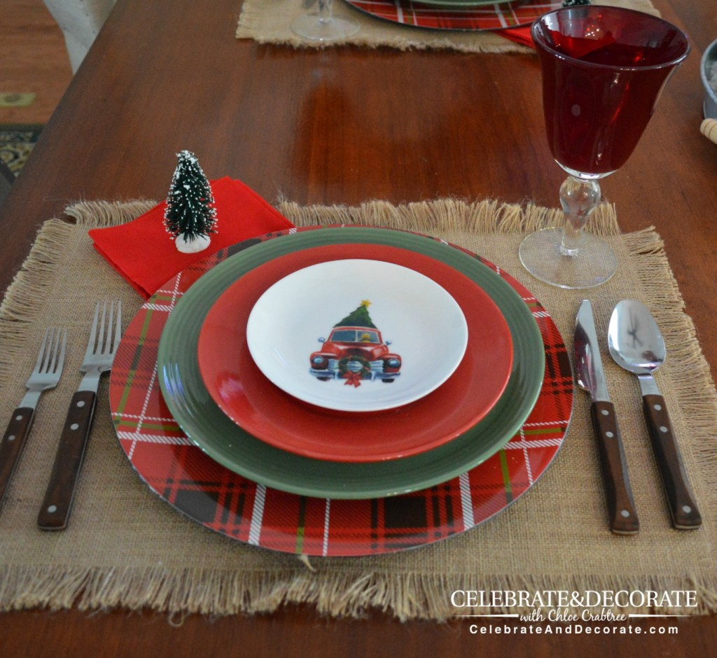 A Rustic Christmas Tablescape with red trucks with trees.
