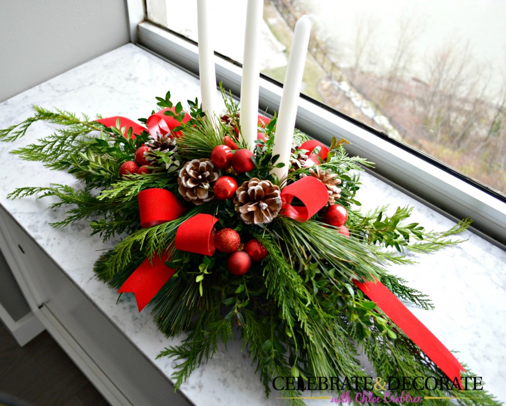 Evergreen and red Christmas Centerpiece with candles