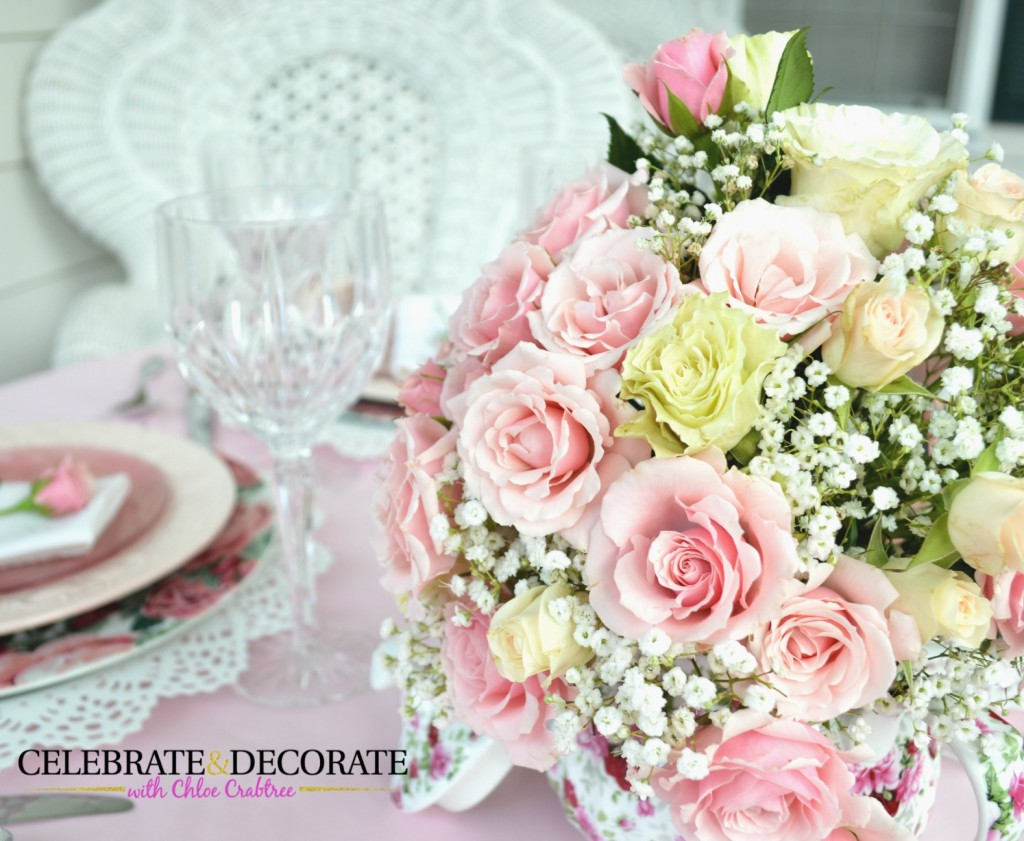 A pretty teapot filled with pink and white roses for a Mother's Day Luncheon