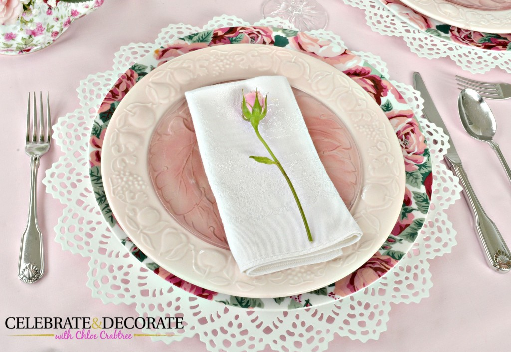 A single rose on each napkin for a Mother's Day tablescape