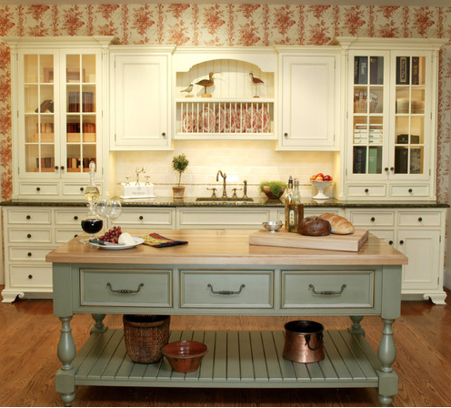 Traditional kitchen with painted island and wallpaper
