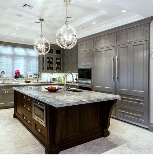 Kitchen with grey painted cabinets.