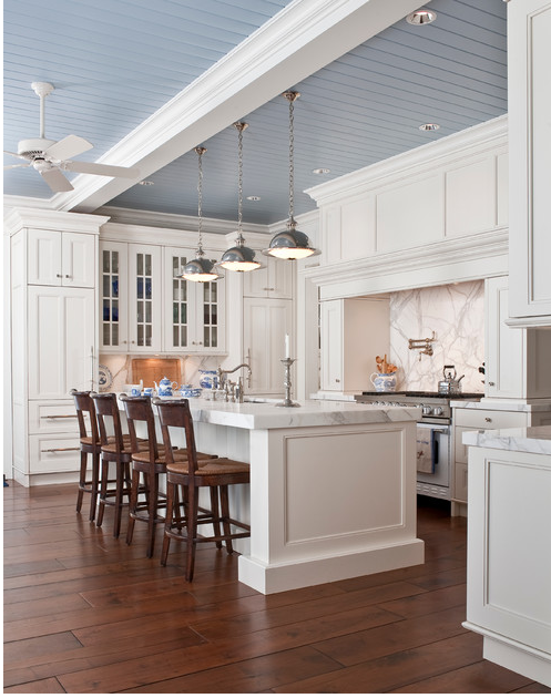 White kitchen with a blue ceiling.