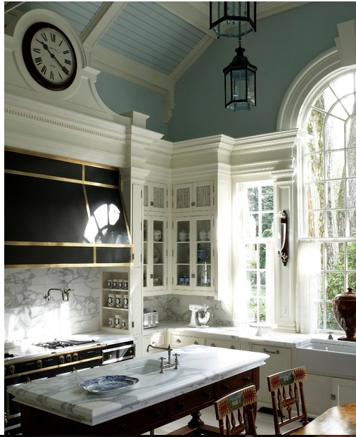 Classic kitchen with amazing windows and beautiful blue ceiling.