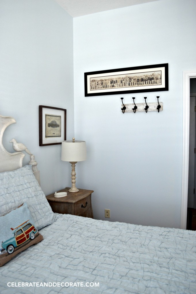 A blue cottage guestroom with vintage photos