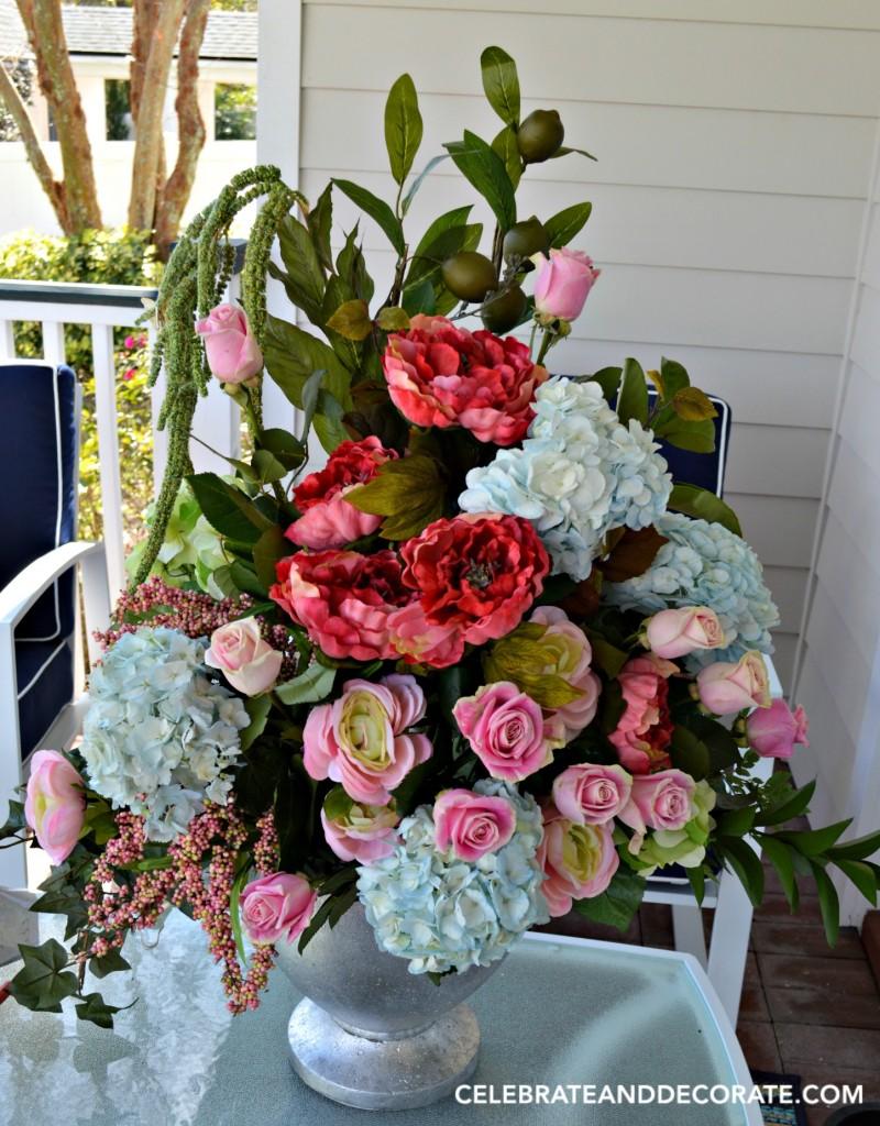A lavish arrangement of fresh and faux flowers