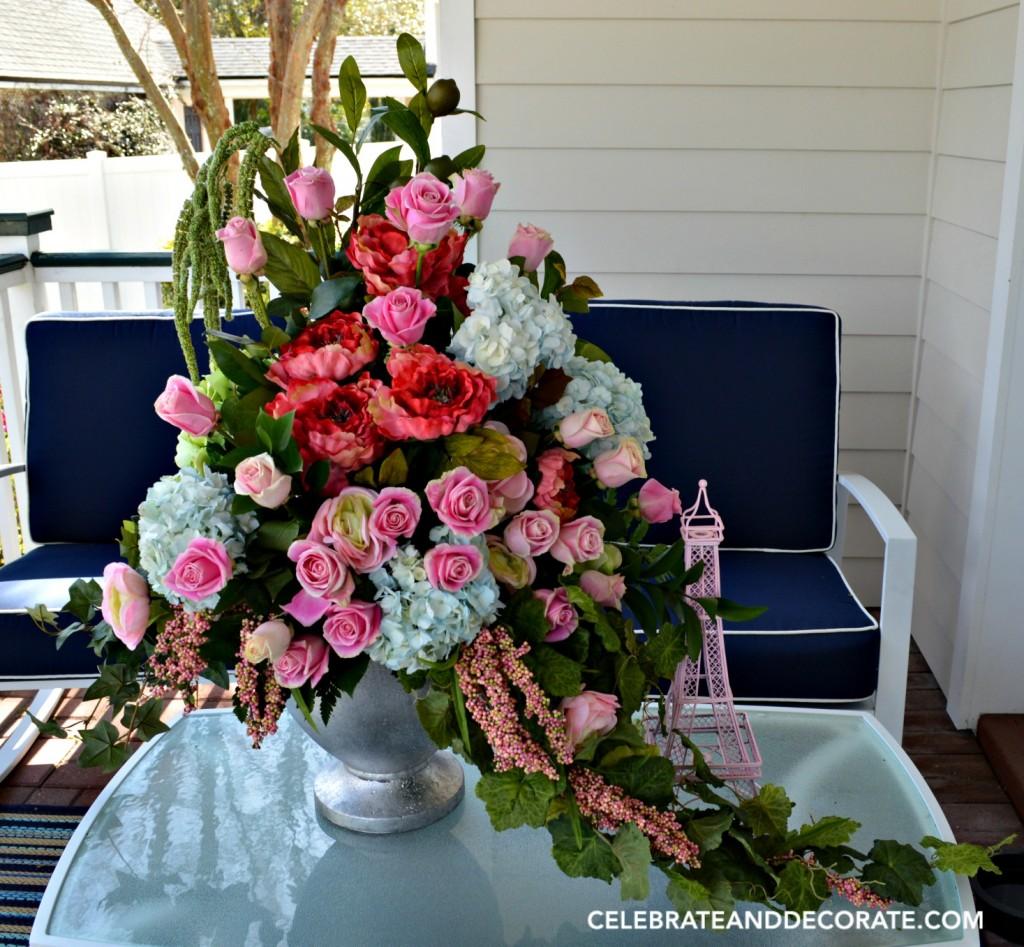 Abundant floral arrangement using a mix of fresh and faux flowers