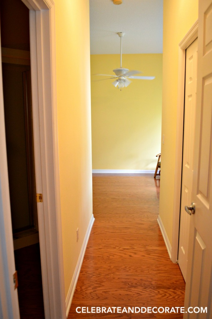 Before picture of hallway into guest room