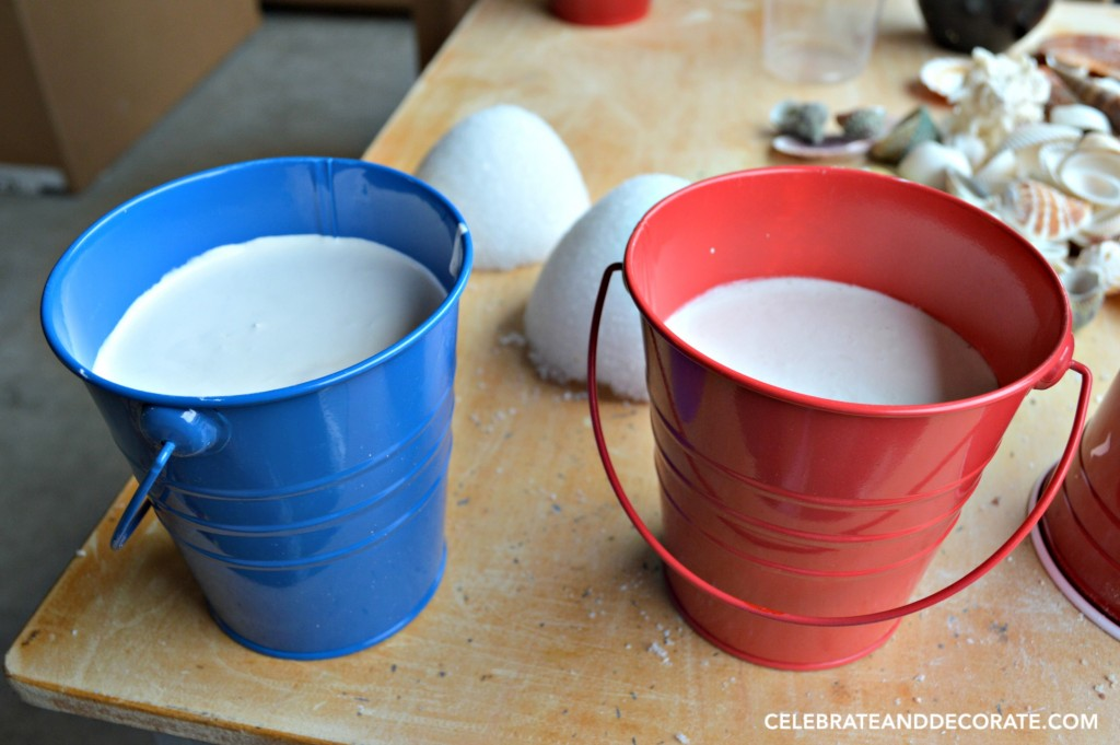 Setting up plaster in sand pails