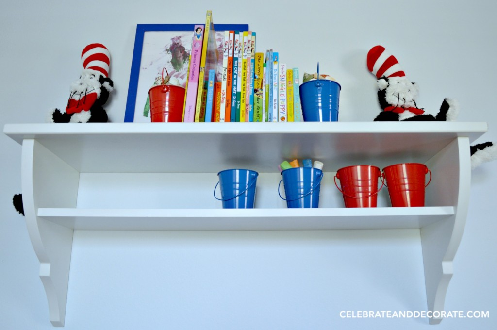 Bookshelves with red and blue pails in a Nautical Nursery