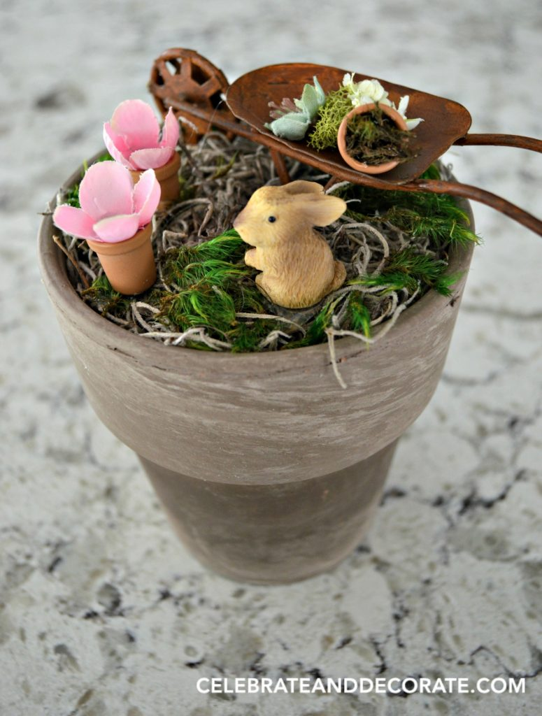 A little bunny in a fairy garden