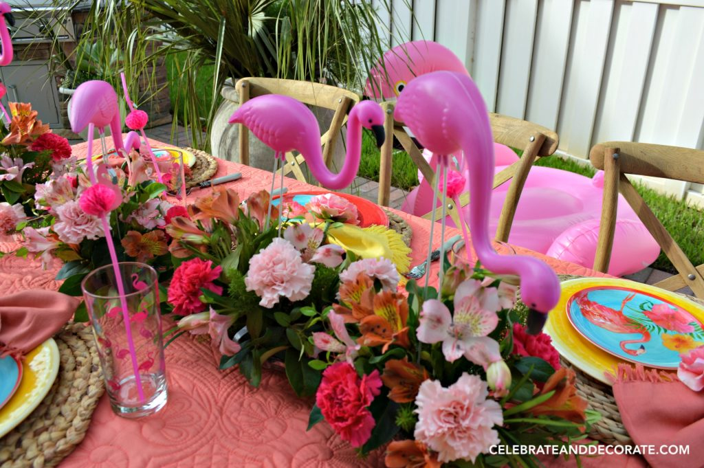 Mini Lawn Flamingos walk along the tabletop
