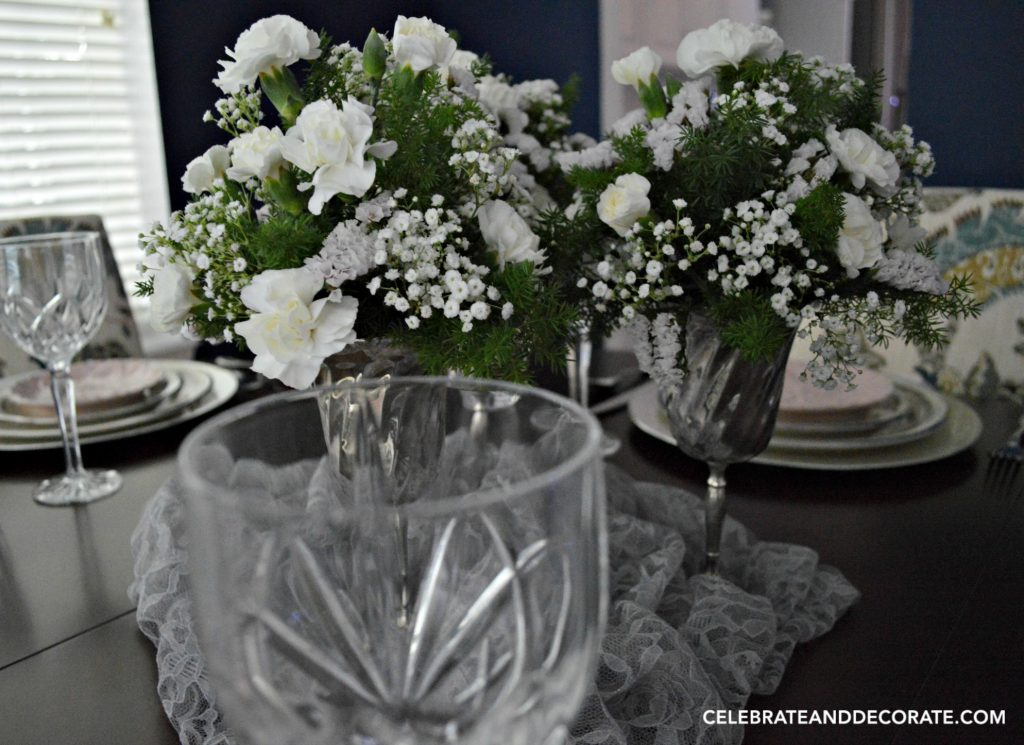 Simple and elegant tablescape with white floral centerpiece