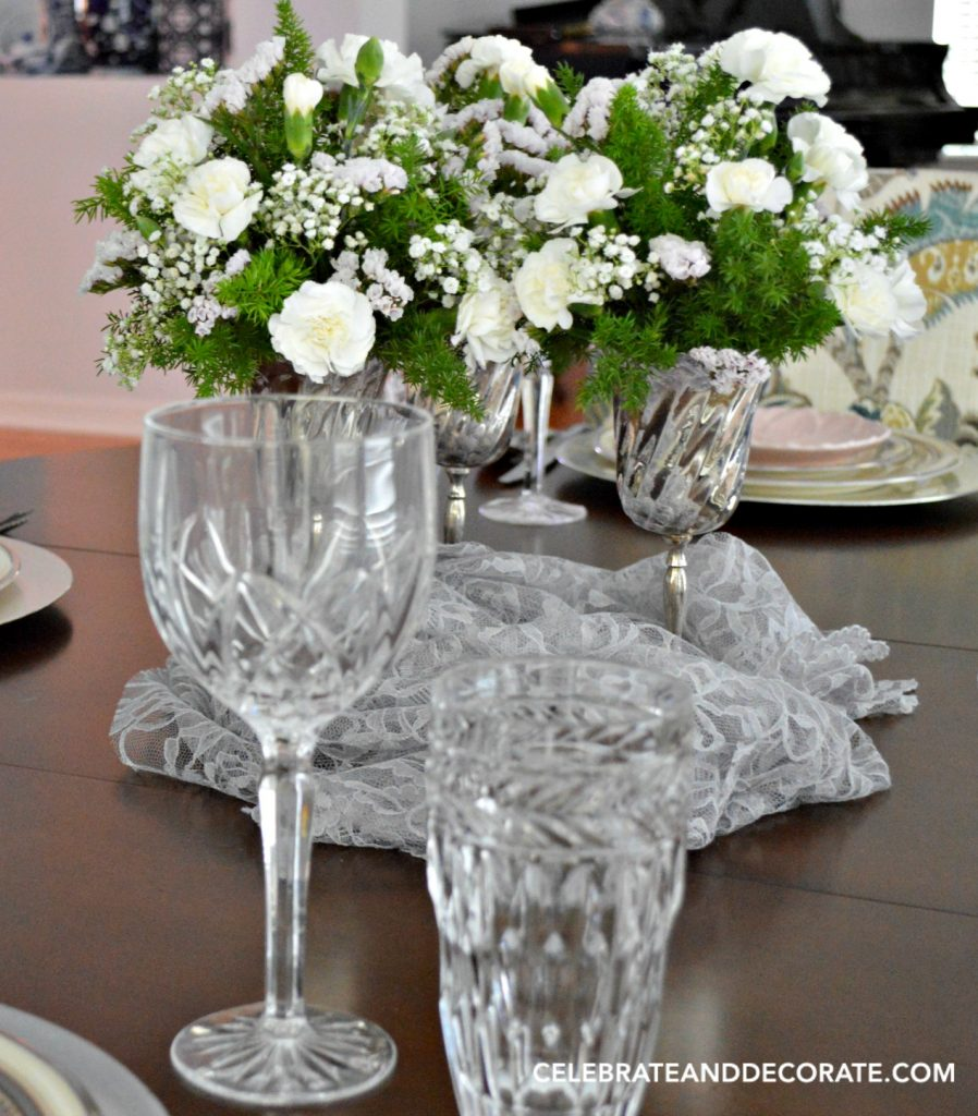 White flowers in silver goblets
