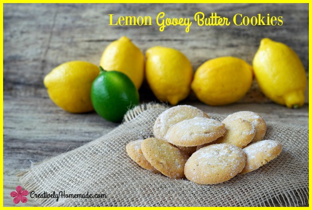 Sweet lemon cookies with lemons and lime in the back