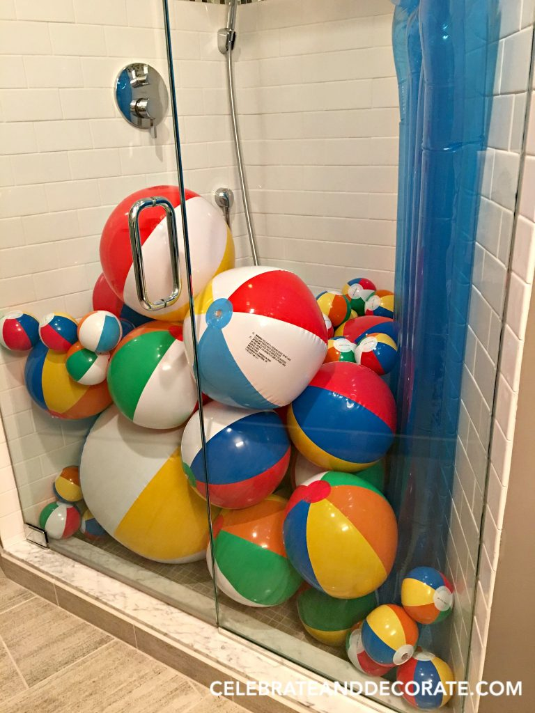 Fill the shower with beach balls for a summer party.
