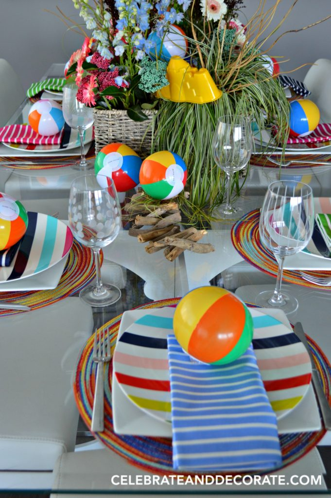 Setting a table for a fun beach ball summer dinner.