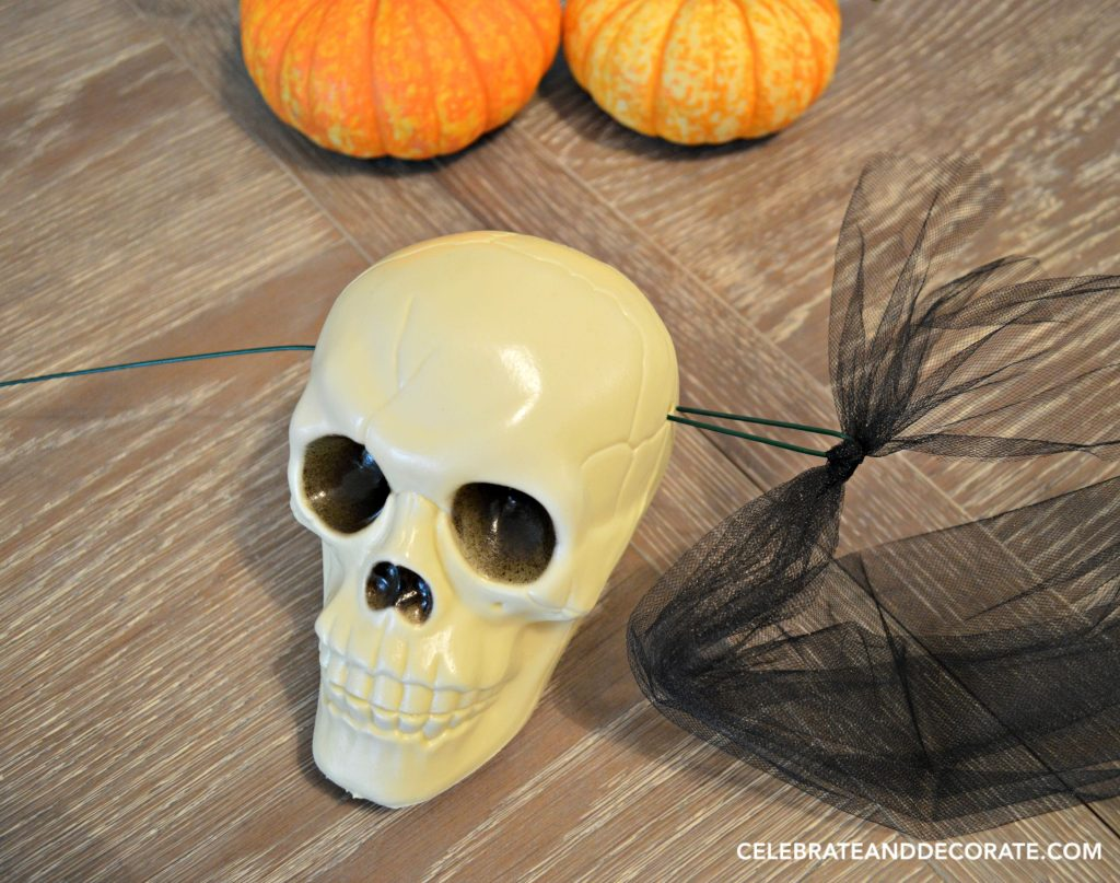 how-to-make-an-easy-dollar-store-skull-garland-for-halloween