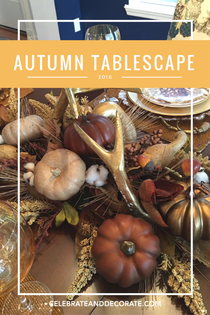 An Autumn Tablescape in browns and golds with golden antlers