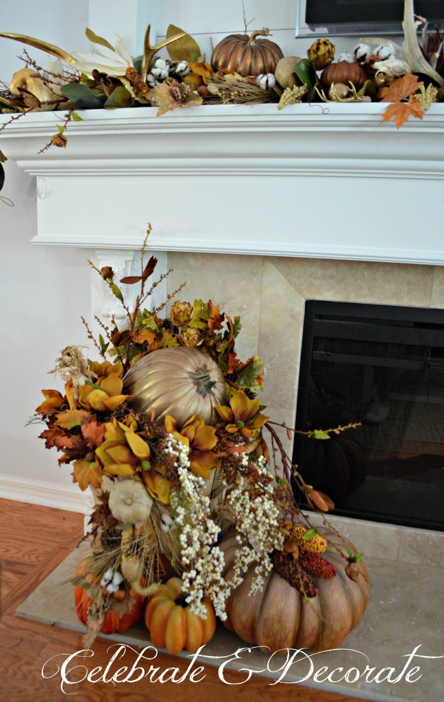 A lavish bushel basket of gourds, leaves and florals rests o the hearth in this lovely Fall display.