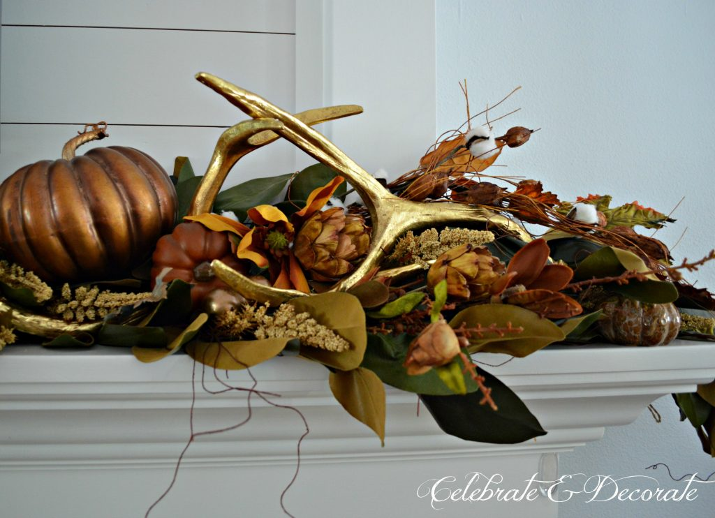 Gold antlers are a striking addition to this mantel display for Fall or Thanksgiving.