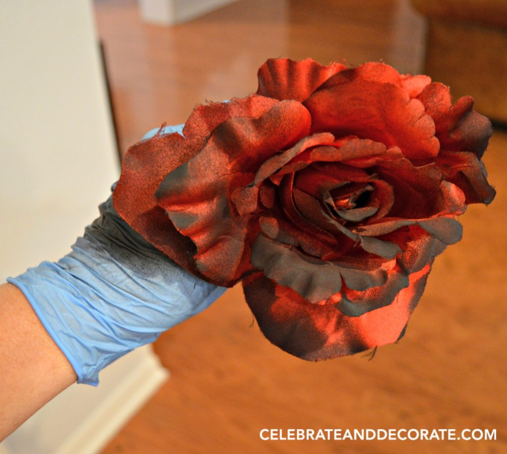 add-black-spray-paint-to-red-roses-for-a-spooky-look