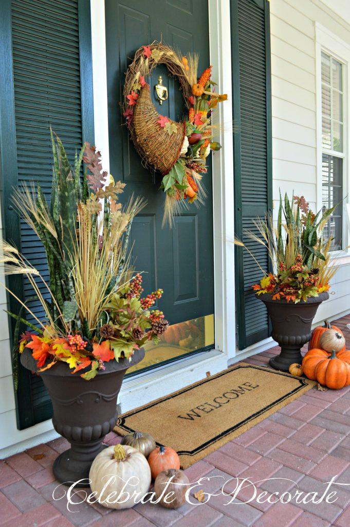 A Cornucopia wreath graces this pretty front porch decorated for Fall