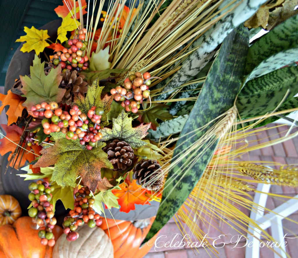 Dress up your plants by adding floral picks and wheat for fall