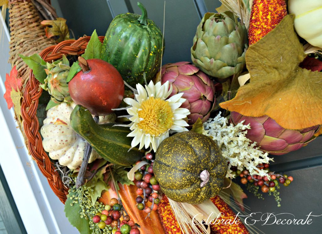 A Cornucopia wreath pours forth with the bounty of the harvest greeting guests for Thanksgiving