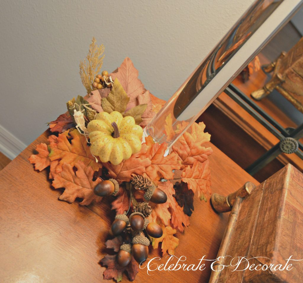 Fall floral picks and Fall leaf candle rings add a touch of Autumn to a pair of candlestick lamps