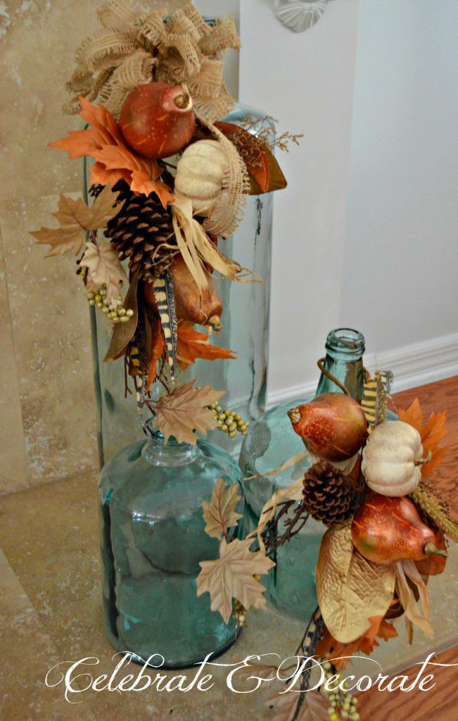 Coastal oversized jars were included in this Thanksgiving display by adding a couple of large Fall floral picks.