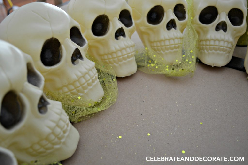 make-a-creepy-halloween-wreath-from-dollar-store-skulls