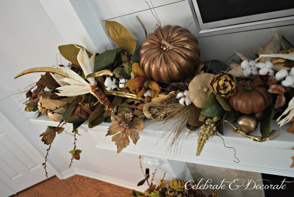 The bounty of the harvest is nestled among a magnolia garland on this Fall mantel.