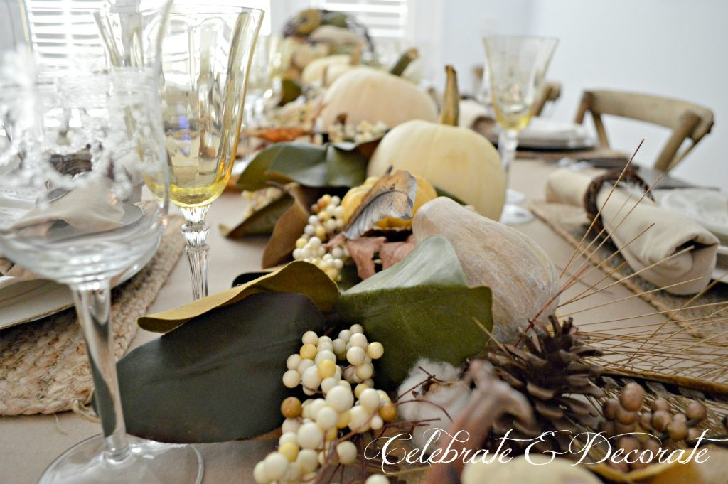 The bounty of the harvest flows down this Thanksgiving table from this grapevine cornucopia