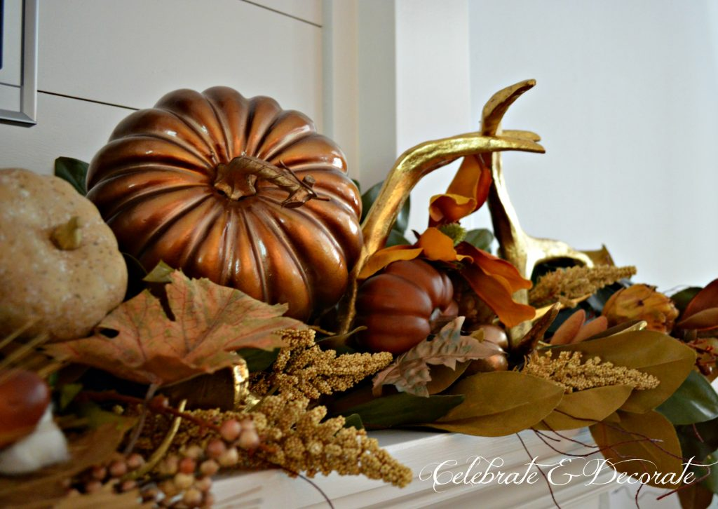 A Fall mantel decorated in gold and brown.