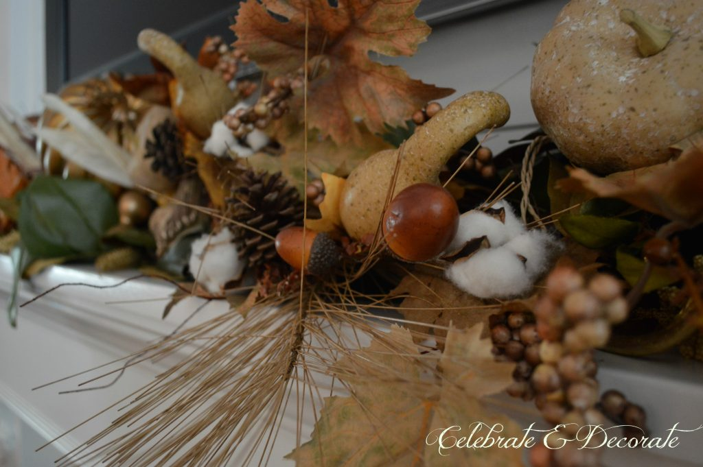 Adding Fall picks to a garland gives this mantel a lovely fullness