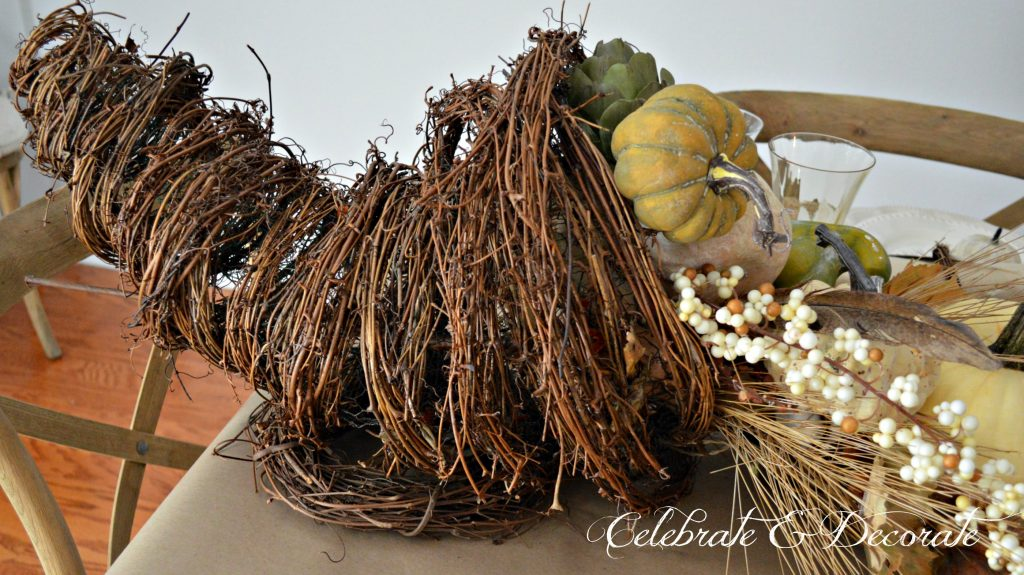 A Grapevine cornucopia graces a Thanksgiving Tablescape