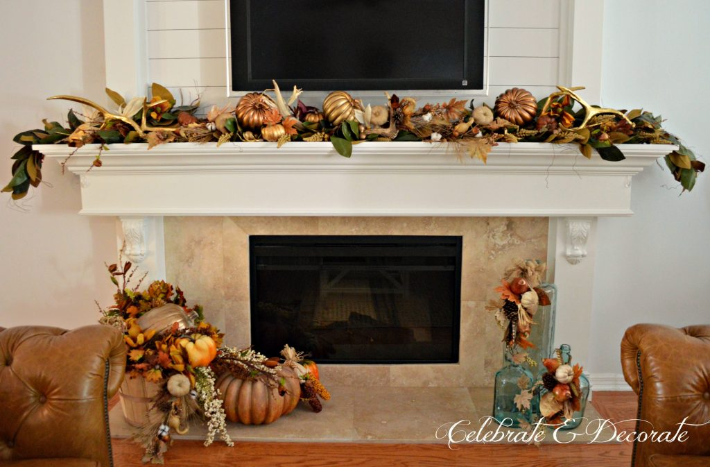 A mantel is decorated with the bounty of the harvest and pretty golden antlers