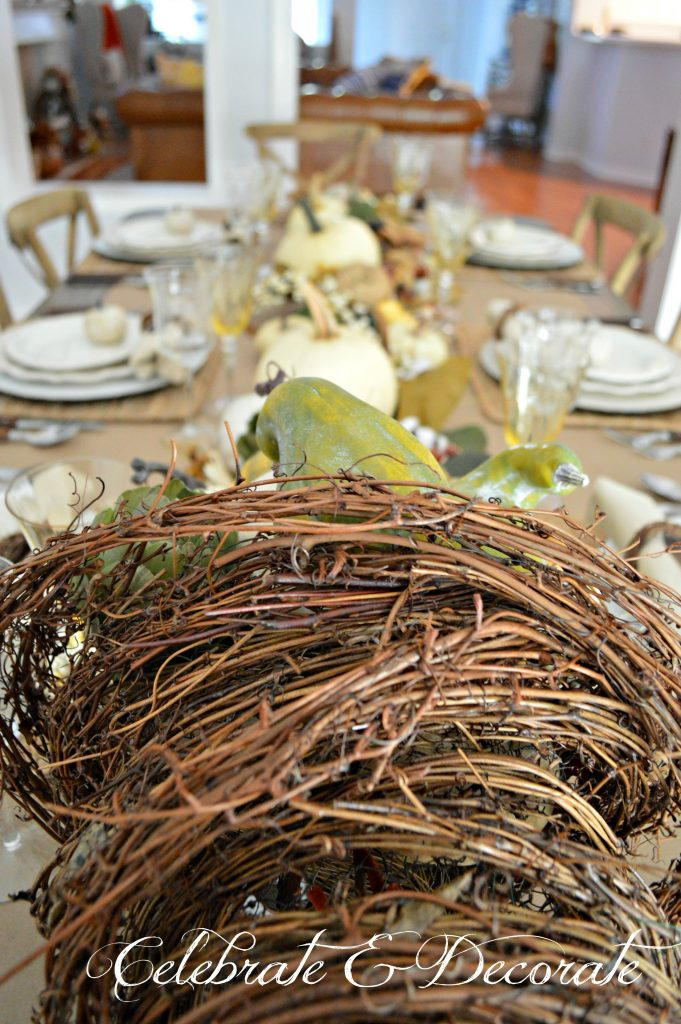 A grapevine cornucopia shares the bounty of the harvest with this Thanksgiving tablescape
