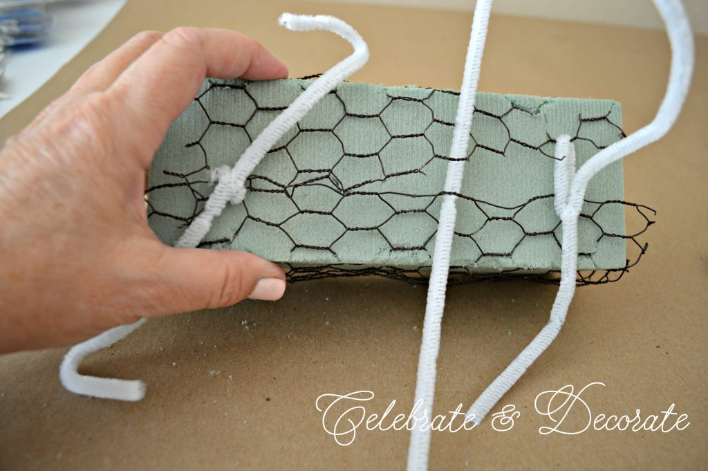 Wrap chicken wire around your floral foam to keep it together when arranging in it.
