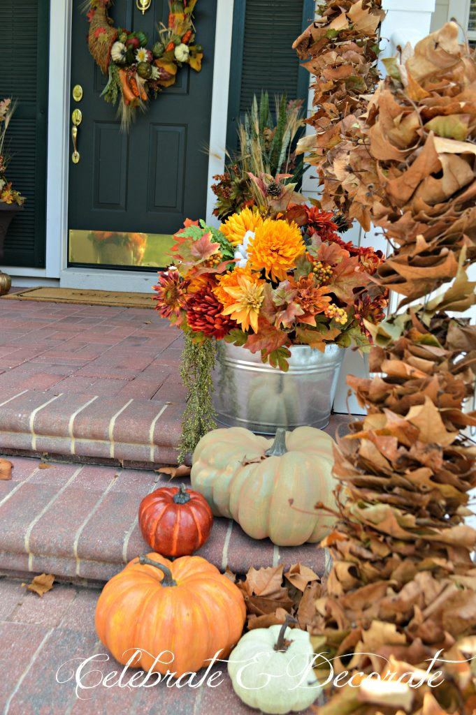 The bounty of the harvest, Fall florals and leaves welcome you to this low country style home