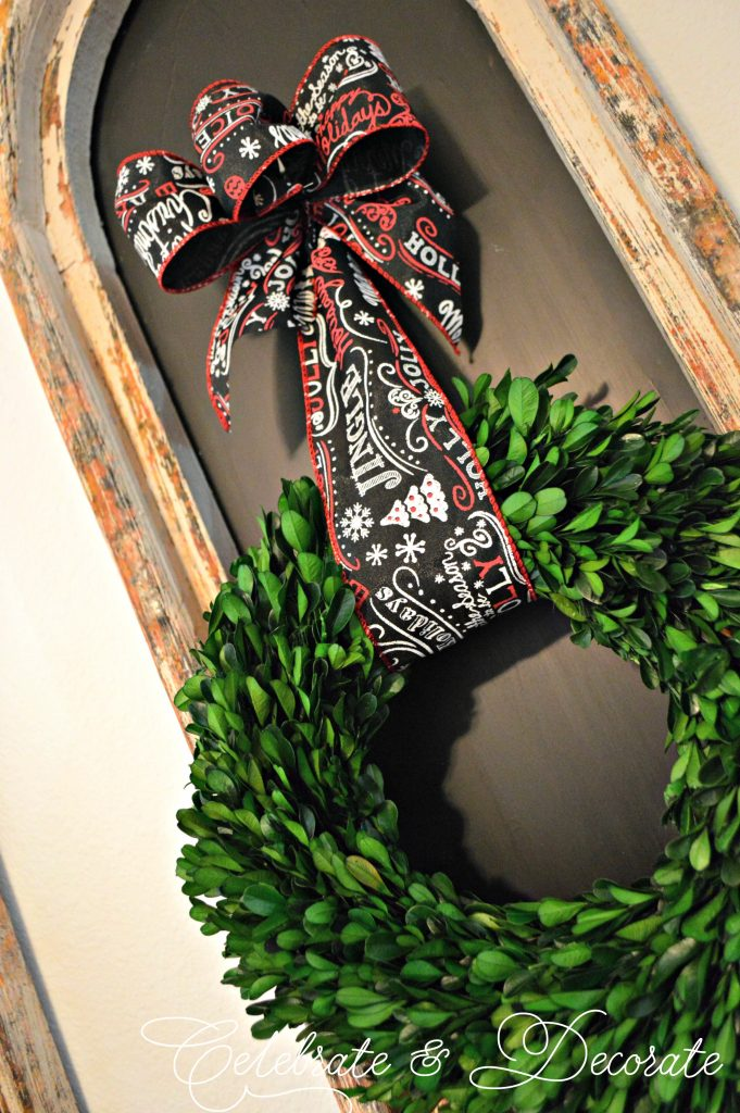 Boxwood wreath tied with chalkboard ribbon for Christmas