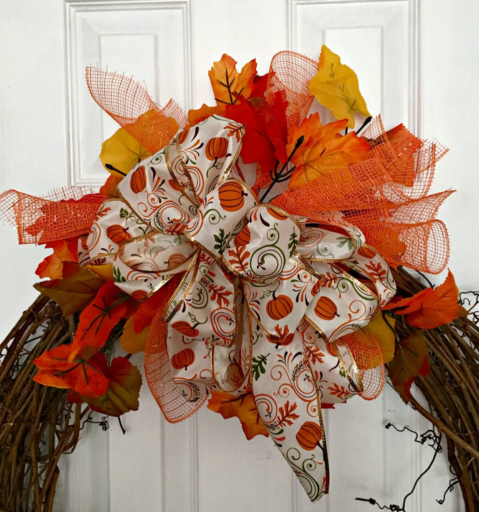 Make a fall wreath with a cute little scarecrow