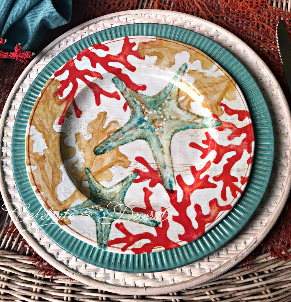 Starfish and coral adorned salad plates top my plate stack for a summertime coastal tablescape