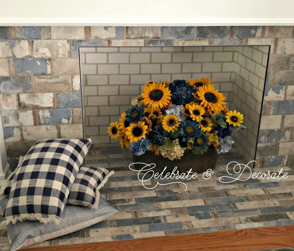 Decorate a fireplace for late summer with sunflowers