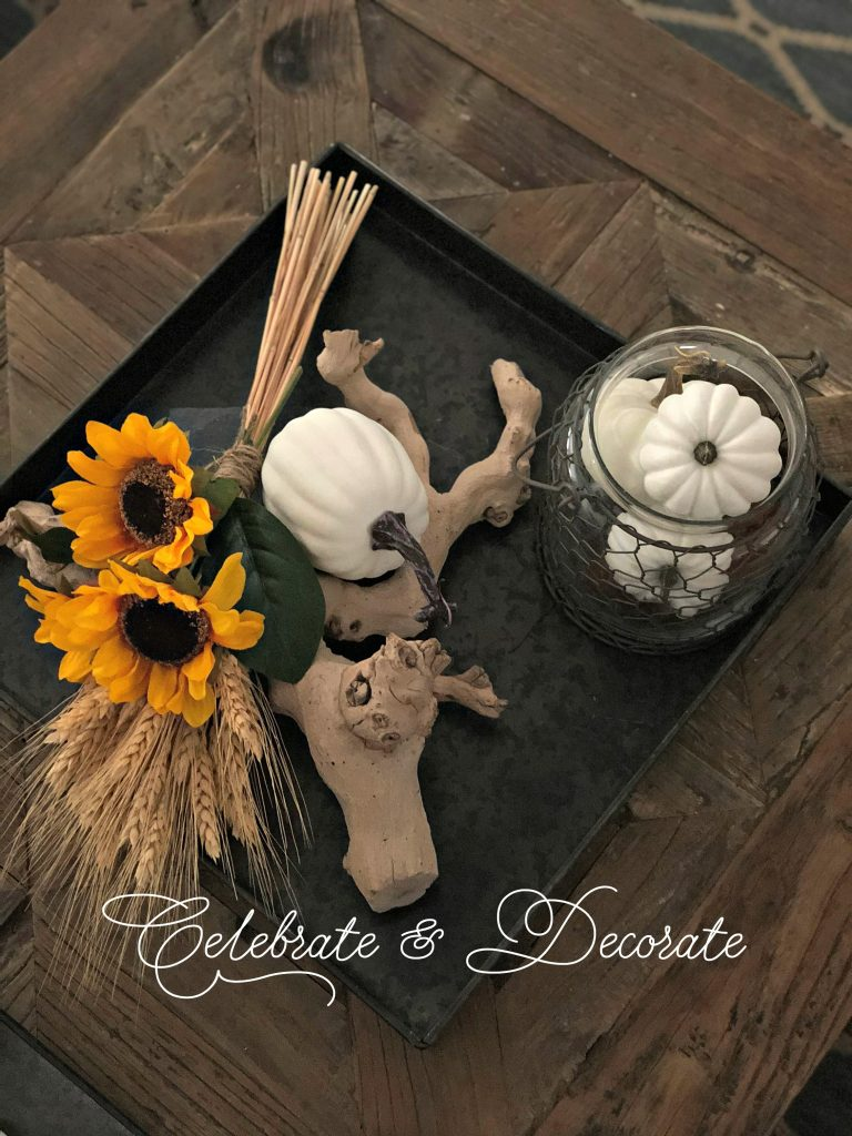 Coffee table vignette featuring sunflowers, wheat and tiny pumpkins