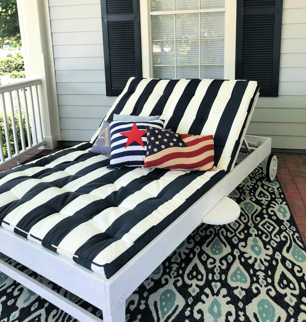 Blue and white cabana striped double chaise with patriotic pillows.