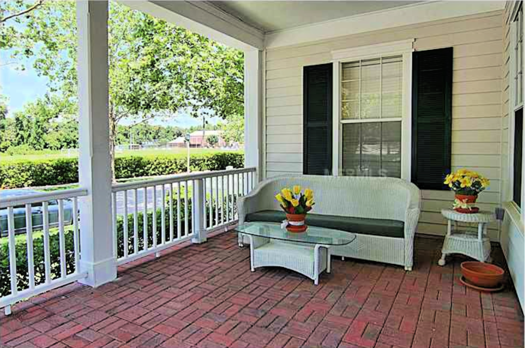 Wicker sofa on the front porch