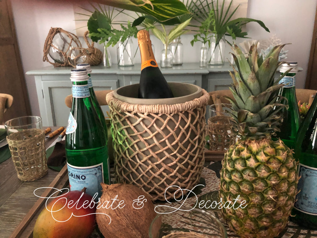 Tropical champagne bucket and tropical fruit centerpiece