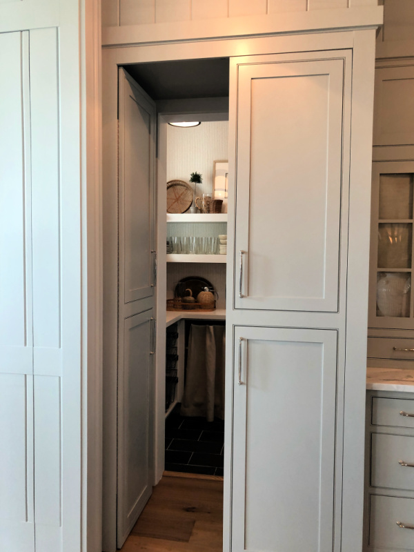 Kitchen pantry with hidden doors